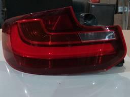 20977295423 7295423 63214818177 63217295423 фонарь левый BMW