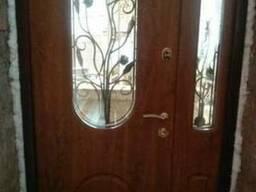 Двері вхідні з ковкою та склопакетами