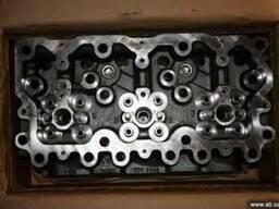 Головка блока цилиндров на рено магнум (без клапанов)