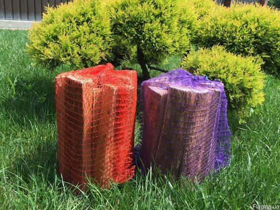 Колотые дрова в сетках