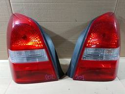 Nissan Primera P12 2001-2007 год Фонарь задний левый правый