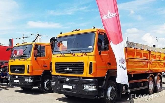 Новый зерновоз МАЗ 6501С5-8535-000 с прицепом МАЗ 856103
