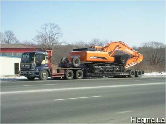 Перевозка спецтехники, услуги перевозки экскаватора бульдозе