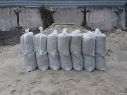 Песок в мешках