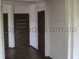Покраска деревянного дома из сруба и бруса