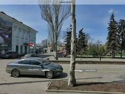Продам здание с большим участком в центре горда