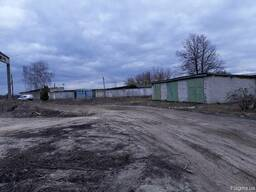 Продам земельный участок 1 га, складские помещения, гаражи.