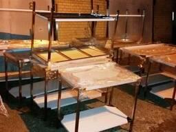 Производственные столы СП из нержавейки с бортом и полкой.
