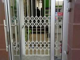 Раздвижные решётки Prof на двери Одесса