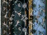 Решетки на окна с художественой ковкой - фото 4