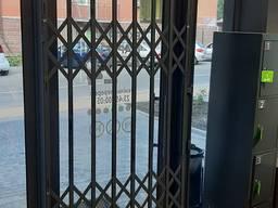 Розсувні решітки металеві на двері вікна балкони вітрини Виробництво і монтаж Ві́нниця