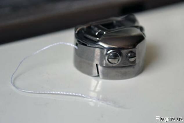 Шпульный колпачок швейных машин