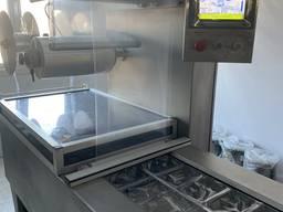 Термоформующая упаковочная машина ТН 4200