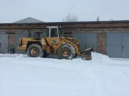 Уборка снега погрузчиком Liebherr