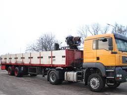 Услуги перевозки тралом с краном манипулятором Украина