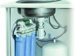 Установка фильтров для воды.