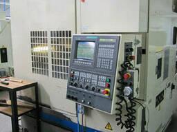 Вертикально-фрезерный обрабатывающий центр Okuma VR 40 II.