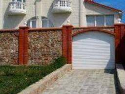 Ворота секційні, гаражні, промислові. Ціна виробника