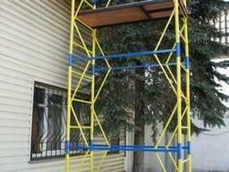 Вышка строительная на колесах с домкратами